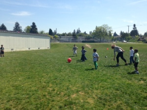 Ms. Eileen playing ball with her students on a beautiful Seattle day!