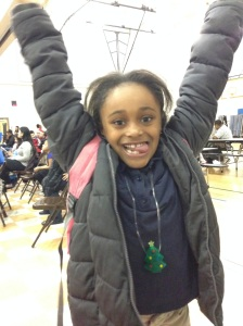 Alivia, an energetic second grader at Emerson, taking the jumping jack challenge!